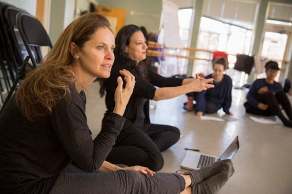 """Amy Brenneman '86 (left) and Sabrina Peck '84 teach """"Performing Our Experience: Tools for Creating Original Theater"""" inside the Director's Studio at the Office for the Arts at 74 Mt. Auburn Street. Kris Snibbe/Harvard Staff Photographer"""