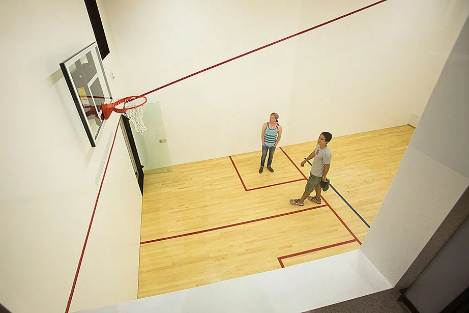 On move-in day, students marvel at the sight of a new squash court with a basketball hoop inside Dunster House. Jon Chase/Harvard Staff Photographer
