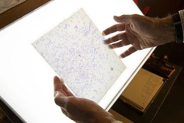 The glass plates collection at the Harvard-Smithsonian Center for Astrophysics serves as a record of skies around the world across more than a century. Jonathan Grindlay is heading up a restoration effort after a January flood threatened the fragile plates.