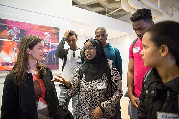 "Julia Kemp (left),  associate director of The Arthur Rock Center for Entrepreneurship, said the Harvard event was ""all about discovery.""  Kemp greeted Brighton High School students Hibo Moallim (center) and Rahwa Gidey (far right) at the Harvard Innovation Lab for the New Venture Competition."