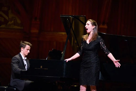 """""""Giving Voice: A Conversation with Placido Domingo"""" takes place in Sanders Theatre at Harvard University. Alex Beyer '17 (left) and Sofia Selowsky '12 perform during the event. Stephanie Mitchell/Harvard Staff Photographer"""