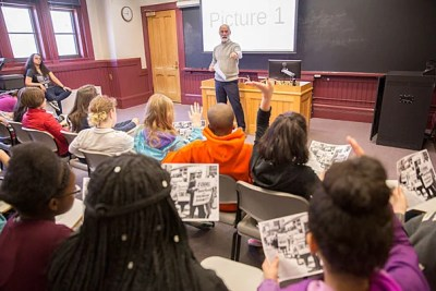 Brett Flehinger, lecturer on history, gives a presentation to seventh-grade students from the Cambridge Street Upper School (CSUS).