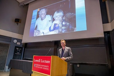 """During the Lowell Lecture, Philippe Cousteau asked the students in the audience to view whatever career they choose through the lens of sustainability. """"Please think about how we can leverage capital markets to change the world, and turn all of this money in a positive direction,"""" he said. Cousteau is pictured with his grandfather, Jacques Cousteau."""