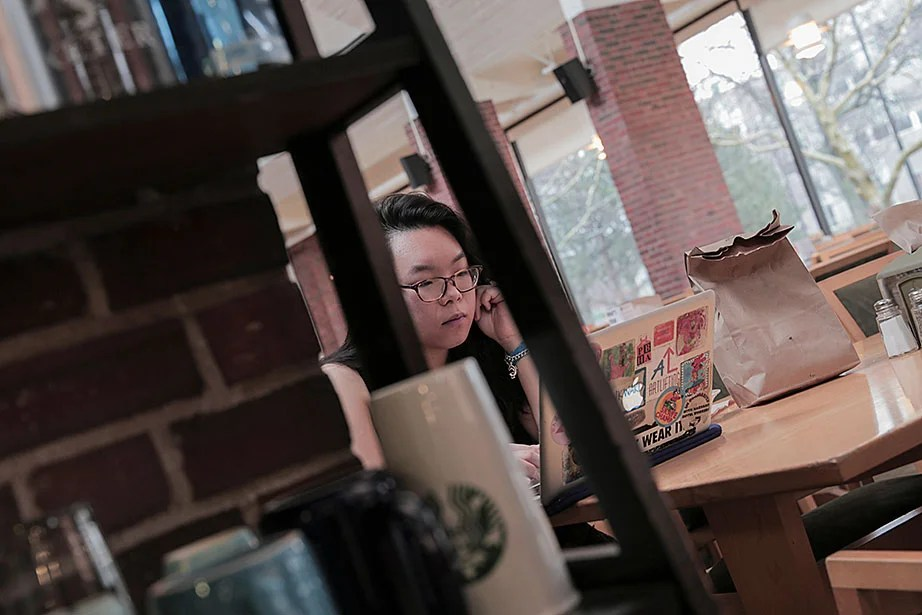 """Jing Qiu '16, who often studies in the Mather House dining hall, said, """"I love being here. You can see the sunset from the glass wall, and when it's the Regatta on the Charles, most of us just sit and watch it from here in our pajamas."""""""