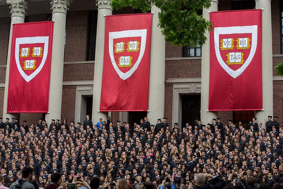 The Class of 2016 gets into place before a class photo is taken on the steps of Widener Library. Kris Snibbe/Harvard Staff Photographer