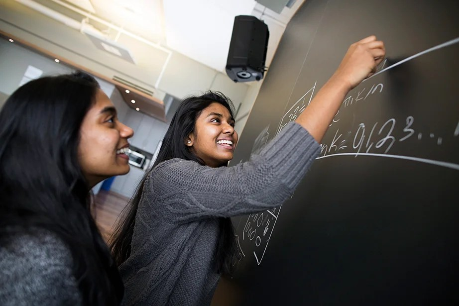 "Since their arrival on campus, the Raheem sisters' relationship has evolved. ""We were put into this whole new world. It is an entirely new way of living … everything about this place is completely revolutionary,"" says Anne. Stephanie Mitchell/Harvard Staff Photographer"