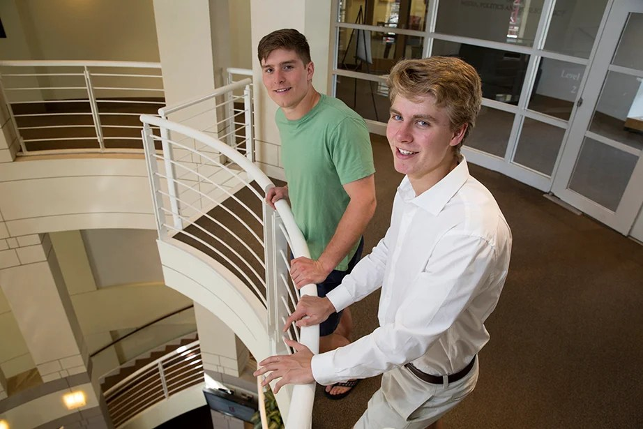 Beau (left) and Nicholas Bayh '18 stand in the Taubman Center at Harvard Kennedy School. Their interest in public service stems from a family legacy: Their grandfather Birch Bayh and father, Evan Bayh, have both served as their state's governor and U.S. senator. Jon Chase/Harvard Staff Photographer