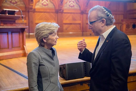 HUIT CIO Anne Margulies talks with speaker Isaac Kohane inside Sanders Theatre. Kris Snibbe/Harvard Staff Photographer