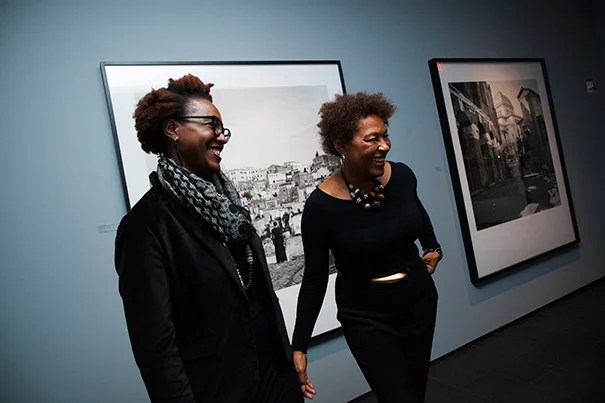 The first solo-artist show at the Ethelbert Cooper Gallery of African and African American Art is a thematic ensemble of provocative work from internationally acclaimed artist Carrie Mae Weems. Nikki Greene (left), assistant professor of art at Wellesley College, and Carrie Mae Weems are pictured during the opening event. Stephanie Mitchell/Harvard Staff Photographer