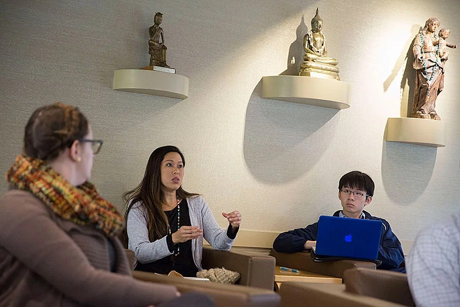 """Vicky Lee (left) and William Wang '20 discuss ballot questions during """"Religion in the News: How Shall We Vote?,"""" a lunchtime event in the CSWR common room."""