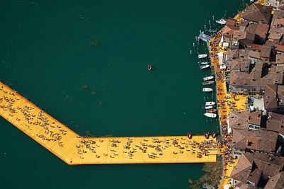 """The Floating Piers"" on Lake Iseo, Italy, was conceived in 1970 yet came to fruition only in the summer of 2016. The 16-meter-wide, shimmering walkways of the project were open and free for the public to traverse for its two-week installation."