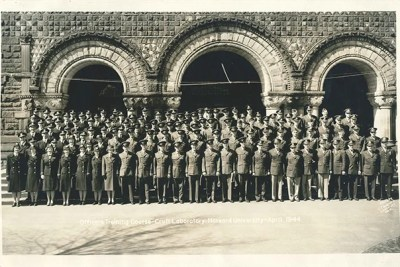 "A photo from the exhibit ""To Serve Better Thy Country,"" depicting ROTC cadets gathering for a photo in front of Crufts Laboratory, April 1944."
