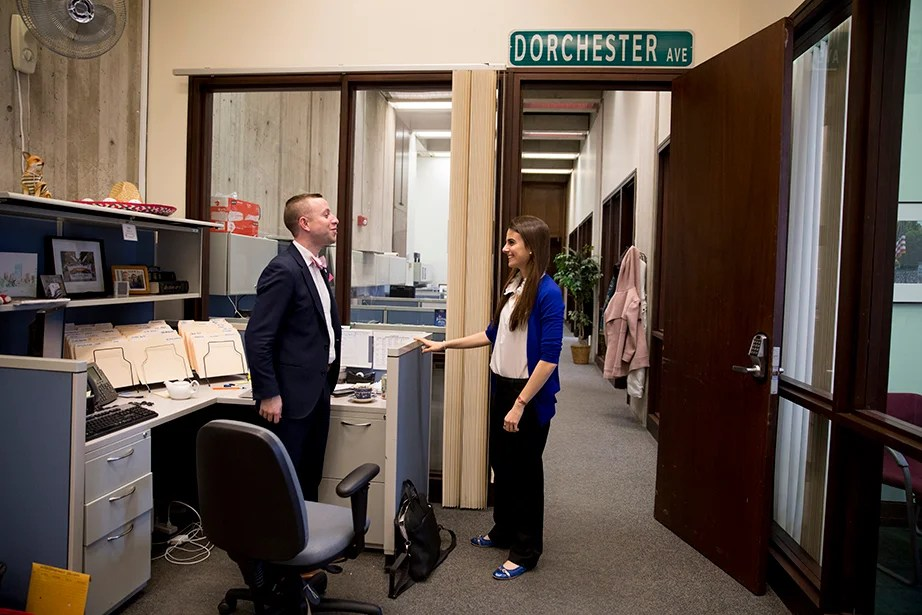 Lender and colleague Alex Zafris talk shop in their office space.