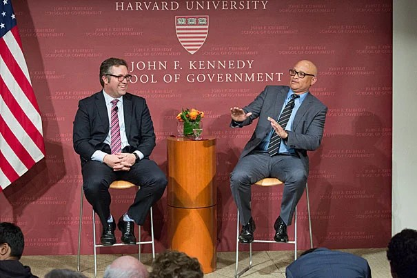 "Director of the Shorenstein Center Nicco Mele (left) laughs at a retort by comedian Larry Wilmore during their talk at the Harvard Kennedy School. ""I do find it ironic that we elect a reality show star as president, and you invite a fake journalist to give the Theodore H. White lecture on it,"" said Wilmore."