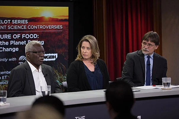Harvard Professor Calestous Juma (from left), Margaret Walsh, senior ecologist, Climate Change Program Office, U.S. Department of Agriculture; and Harvard Chan School's Gary Adamkiewicz, discuss the effects climate change will have on food security in the U.S. and Africa.