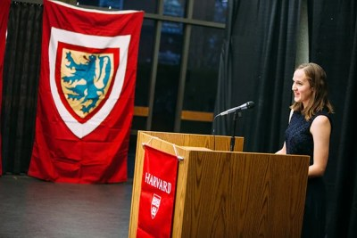"""Eliza Pugh '16-'17 delivers the """"Student Reflection"""" at the Midyear Graduates Recognition Ceremony on Dec. 2. """"Bring that sense of adventure and wonder that you felt when you were forging your own road less traveled by to the next phase of your life."""""""