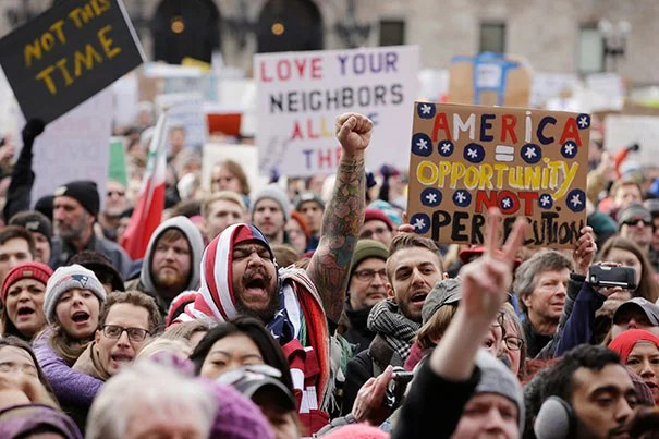 Protesters gathered in Boston's Copley Square on Sunday to rally against President Donald Trump's executive order that restricts travel to the U.S. from seven predominantly Islamic countries.