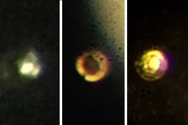 Microscopic images of the stages in the creation of atomic molecular hydrogen: Transparent molecular hydrogen (left) under about 200 gigapascals (GPa) of pressure, which becomes black molecular hydrogen, and finally reflective atomic metallic hydrogen at 495 GPa. Courtesy of Isaac Silvera