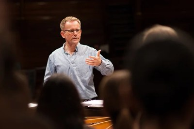"""Grammy-winning composer Craig Hella Johnson returns to Boston Symphony Hall to lead an innovative rendition of his piece """"Remembering Matthew Shepard,"""" in which  110 Harvard students interspersed throughout the audience will join in with the performers onstage during the show's finale."""