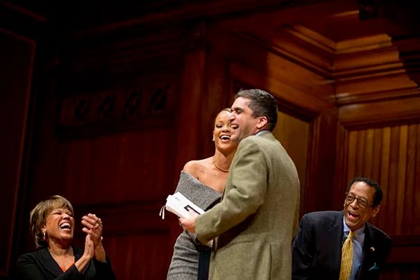 Pop star Rihianna (Robyn Rihanna Fenty) hugs Dean of Harvard College, Rakesh Khurana following his remarks. On left is Reverend Liz Walker, Mdiv '05 and and on right is Dr. S. Allen Counter, Director of the Harvard Foundation that awarded Rhianna the Humanitarian of the Year award at Sanders Theatre at Harvard University Rose Lincoln/Harvard Staff Photographer
