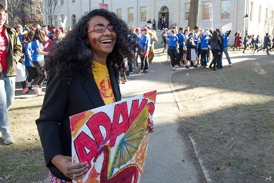 Eboni White '17 from Adams shows support to her House by holding a sign. Photo by Silvia Mazzocchin