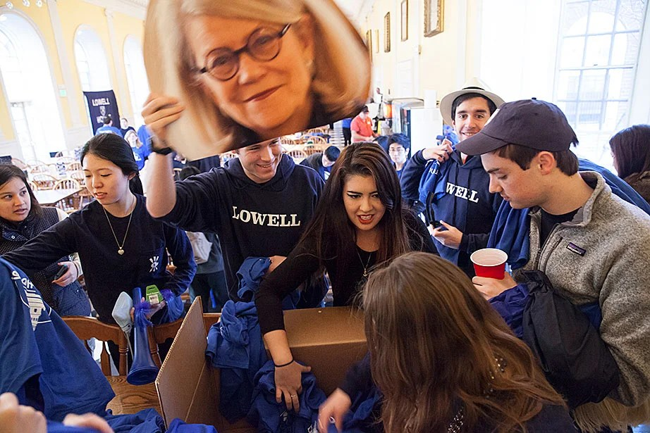 Lowell House students, hoisting a photo of Faculty Dean Diana Eck, gather in the dining room to don T-shirts before marching to Harvard Yard for Housing Day, when freshmen receive their housing assignments for the next three years. Jon Chase/Harvard Staff Photographer