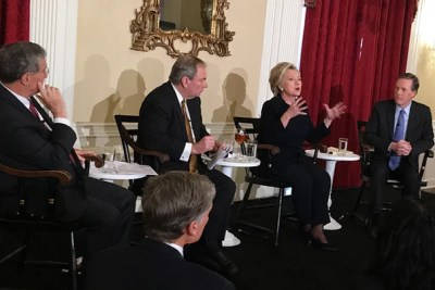 Hillary Clinton answers questions from faculty and students at a luncheon in Loeb House, with Professors Robert Mnookin (from left), James Sebenius, and Nicholas Burns joining her.