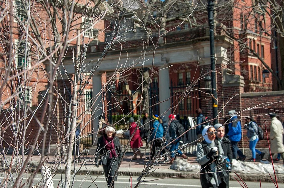 The Class of 1875 Gate, Southwest, faces the hustle and bustle of Harvard Square. It welcomes passersby to find relief in the Yard's quiet atmosphere.