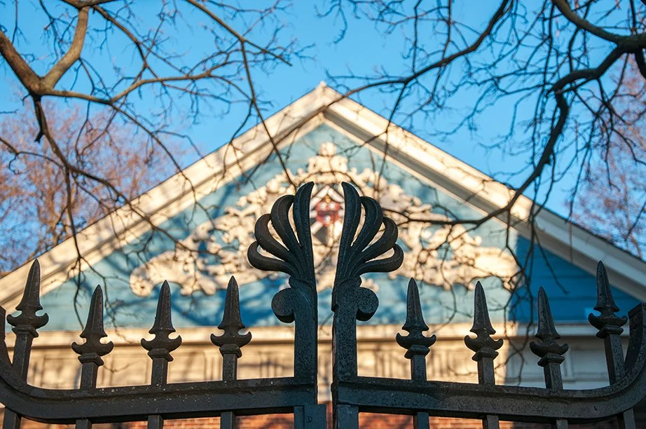 "The Class of 1870 Gate, Northwest. The gate's ornaments embrace the design of the back door of Holden Hall. The gate, always locked, keeps preserved and inaccessible the beauty of the ""secret garden"" behind the hall."