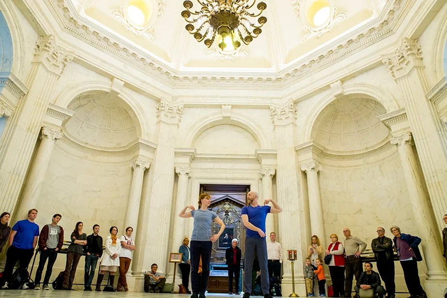 "Under the creamy-colored columns and ornate arches of the Widener Library Rotunda, Christopher Roman and Jill Johnson silently present ""Catalogue (First Edition),"" created by and with William Forsythe, their choreographer, teacher, mentor, and friend. Rose Lincoln/Harvard Staff Photographer"