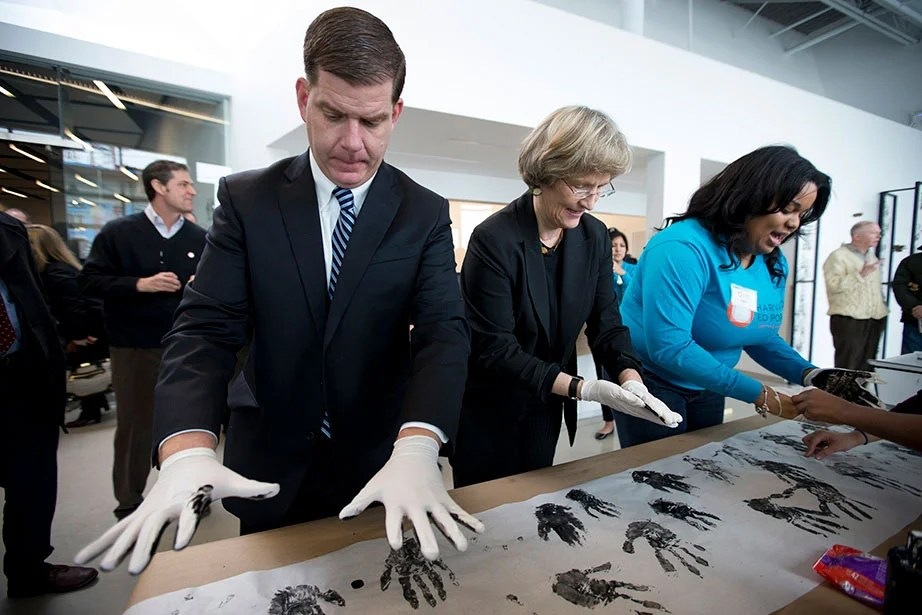 Boston Mayor Martin J. Walsh joins President Faust at the grand opening of the Harvard University Education Portal in February 2015. Located at the crossroads of the North Allston-Brighton neighborhood and Harvard's campus in Allston, the Ed Portal serves as a place for members of the Allston-Brighton and Harvard communities to come together to participate in programs, share ideas, and learn from one another. Rose Lincoln/Harvard Staff Photographer