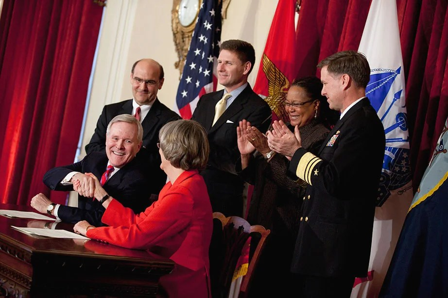 After a 40-year hiatus, Faust initiates the reinstatement of a Reserve Officers' Training Corps (ROTC) program on campus, signing an agreement with Navy Secretary Ray Mabus, J.D. '76, in March 2011. Harvard signed similar agreements to reinstate Army ROTC in 2012 and Air Force ROTC in 2016.  Stephanie Mitchell/Harvard Staff Photographer
