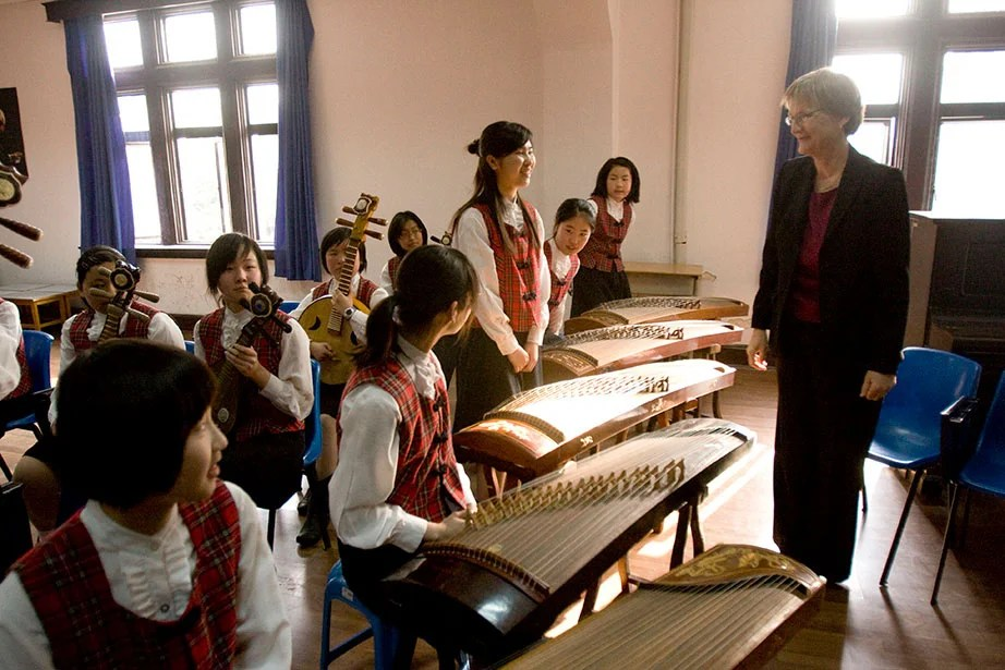 On a trip to China, President Faust visits with students at the Shanghai No. 3 Girls High School. Faust has visited with a number of secondary schools in the U.S. and abroad to reinforce the importance of higher education. Kris Snibbe/Harvard Staff Photographer