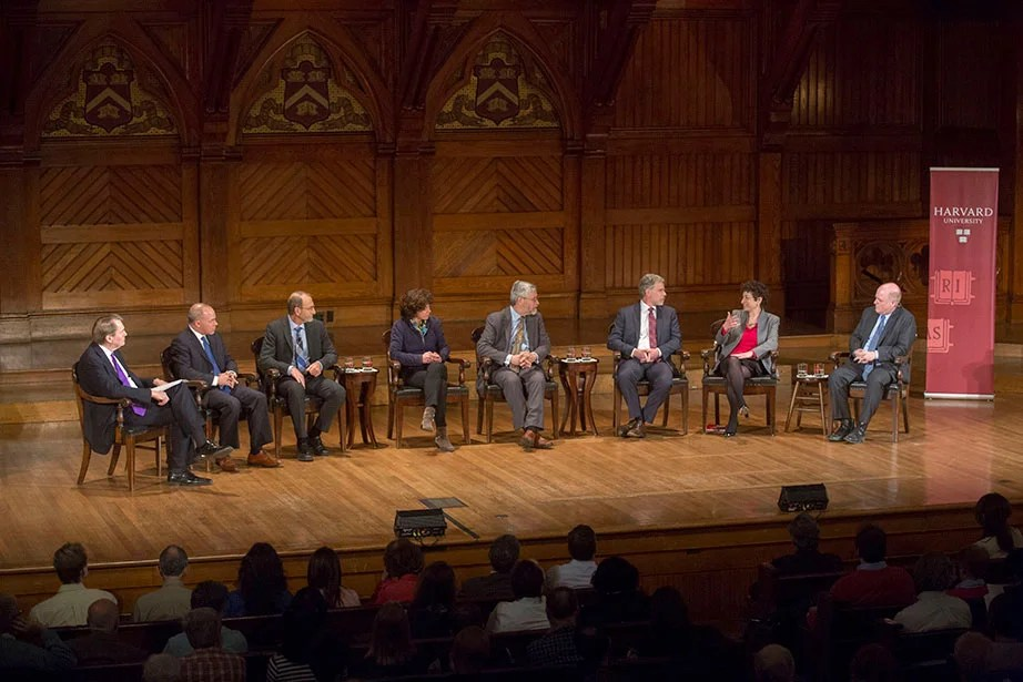 At Sanders Theatre, Charlie Rose (from left) moderates a climate change panel in 2015 with Joseph Aldy, assistant professor of public policy, Harvard Kennedy School; Christopher Field, co-chair, Working Group II of the Intergovernmental Panel on Climate Change; Rebecca Henderson, McArthur University Professor; John Holdren, assistant to the president for science and technology at the White House; Richard Newell, Gendell Professor of Energy and Environmental Economics; Naomi Oreskes, professor of the history of science; and Daniel Schrag, Sturgis Hooper Professor of Geology. As part of a University-wide focus on addressing climate change, Faust set out ambitious greenhouse-gas reduction goals for the institution in 2008, aiming to reduce its emissions, including those associated with prospective campus growth, by 30 percent—relative to its 2006 baseline—by 2016. Kris Snibbe/Harvard Staff Photographer