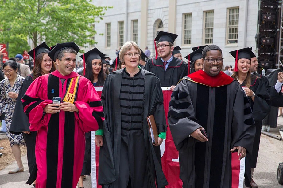 Dean of Harvard College Rakesh Khurana (from left) and members of the Class of 2017 gather for the Baccalaureate Service in the Memorial Church. President Faust and the Rev. Jonathan Walton, the Plummer Professor of Christian Morals (right), lead the procession. Kris Snibbe/Harvard Staff Photographer