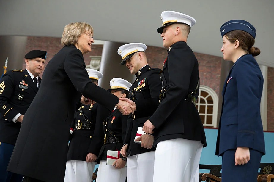 "President Faust congratulates seniors during the ROTC Commissioning Ceremony for the Class of 2014 in Tercentenary Theatre. At the return of the Air Force ROTC regiment in 2016, Faust thanked members of the Harvard community who have served in the military, noting what she called a ""commitment to shared values—service, community, inclusion, and opportunity."" Stephanie Mitchell/Harvard Staff Photographer"