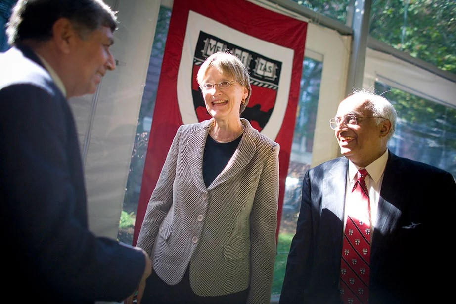 """President Faust (center) oversees the formation of the School of Engineering and Applied Sciences (SEAS)—the first new Harvard School since 1936. Dean Venkatesh """"Venky"""" Narayanamurti (right), first dean of SEAS, is pictured here with Ashok Misra of the Indian Institute of Technology Bombay. In 2015, the School was renamed the Harvard John A. Paulson School of Engineering and Applied Sciences in recognition of Paulson's transformative $400 million gift. Photo by Justin Ide"""
