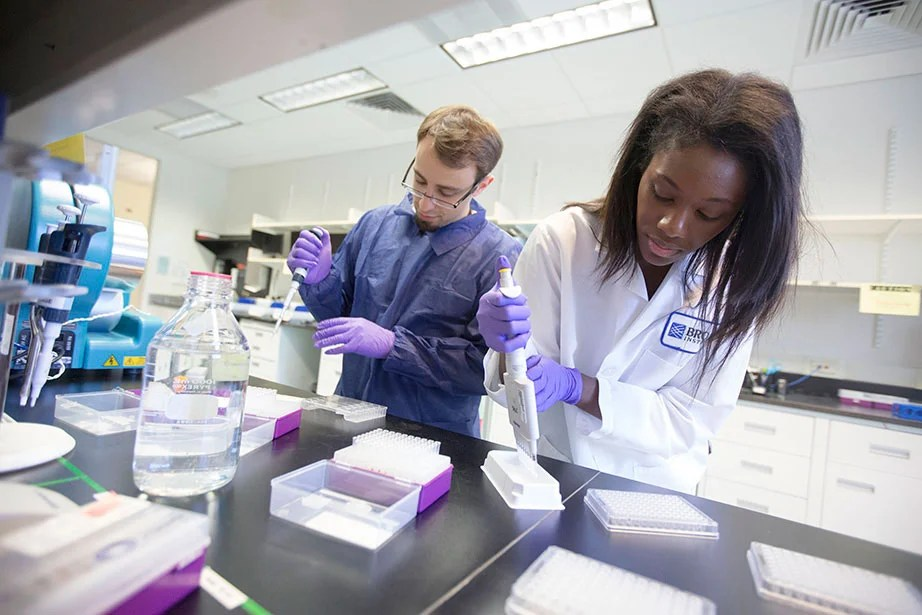 The Eli and Edythe L. Broad Institute of MIT and Harvard, which was endowed with a $400 million gift in 2008, is a biomedical and genomic research facility. Here, Cassandra Elie and Kevin Joseph ready whole-genome samples using sage pippin preparation. The Broad brings together faculty and scientists from across MIT, Harvard, and the Harvard-affiliated hospitals and beyond to tackle ambitious and important challenges in biomedicine. Kris Snibbe/Harvard Staff Photographer