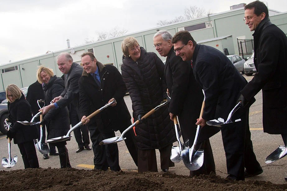 Boston Mayor Thomas M. Menino and President Faust attend a groundbreaking at Barry's Corner in December 2013, a major step in realizing the University's vision for Allston. Harvard's growth in the city includes the Harvard Innovation Labs, a residential development, and the reimagining of a Science and Engineering Complex that will open by 2020 and serve as the primary home for the Harvard John A. Paulson School of Engineering and Applied Sciences. Photo by Michelle Jay