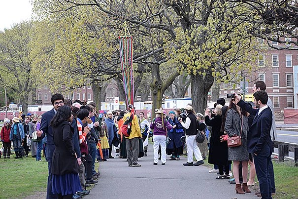 Every year in the early hours of May 1, the residents of Lowell House gather on the John Weeks Footbridge to take part in a May Day ritual to celebrate the end of the school year and relax before the start of finals.