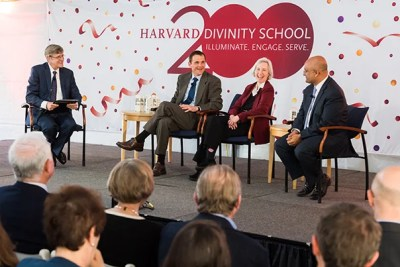 David N. Hempton (from left), dean of the Harvard Divinity School, moderates a panel with fellow deans James Ryan of the Ed School, Martha Minow of the Law School, and Nitin Nohria of the Business School about how they see the Divinity School's role in the University and the world.