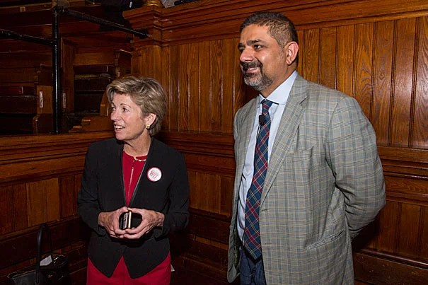 Harvard CIO Anne Margulies chats with Karim R. Lakhani, professor of business administration at the Business School, before his afternoon keynote address at the annual IT Summit.