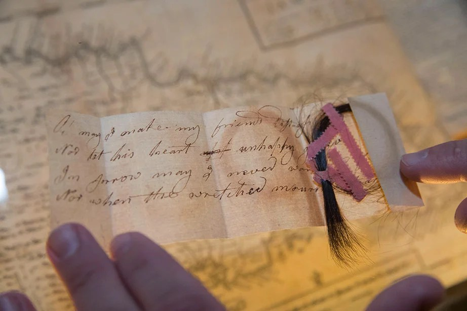"Elizabeth Lincoln sent this lock of hair to Samuel Norton, ca. 1780, with the final lines of ""The Friend"" by Anne Steele: ""Oh may I make my friend's distress my own — Nor let my heart unhappy grieve alone — In sorrow let me never want a friend — Nor when the wretched mourn a tear to lend."" Collection of Houghton Library."