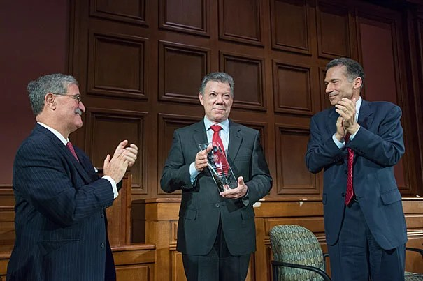 Colombian President Juan Manuel Santos (center) received the Great Negotiator Award at HLS. Santos was honored for his work to end Colombia's 52-year civil war.