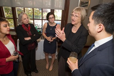 President Faust speaks with Lamees El-Sadek, Dr.P.H. '19 (from left), Robin Mount, director of FAS Office of Career services, Juliet Lewis '18, and Christopher Higginson '18 at the Annual luncheon for recipients of the Presidential Public Service Fellowship.