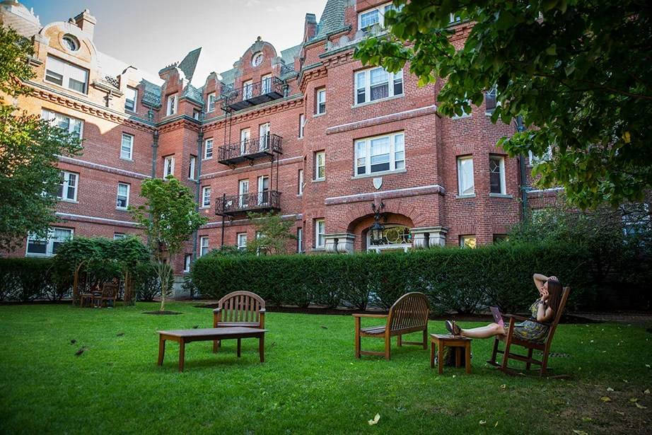 """The residences with views of the courtyard were originally called """"Gold Coast"""" dormitories. They were built from 1893–1902 to provide luxurious accommodations for rich Harvard undergraduates."""