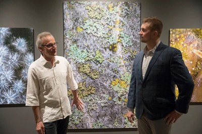 """Roberto Kolter (left) and Scott Chimileski combine art and science in the photo exhibit """"World in a Drop,"""" on view at the Museum of Natural History through Jan. 7."""