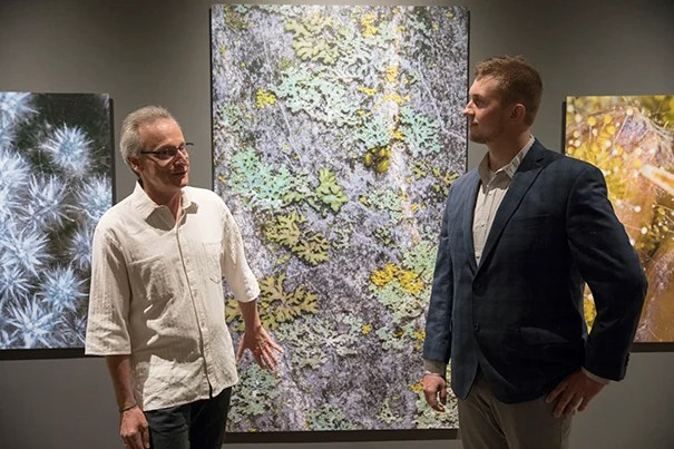 "Roberto Kolter (left) and Scott Chimileski combine art and science in the photo exhibit ""World in a Drop,"" on view at the Museum of Natural History through Jan. 7."