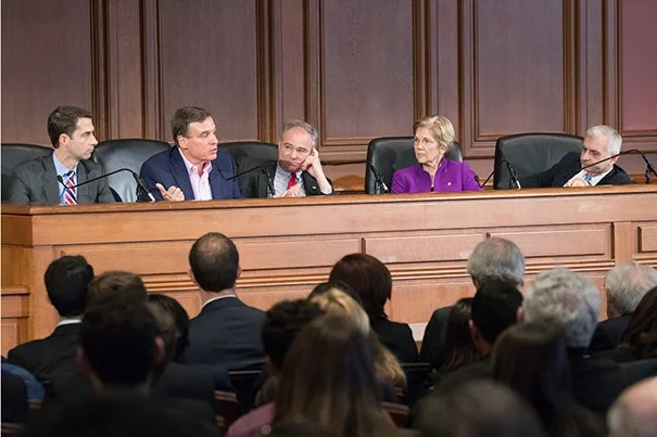 From left, moderator David Gergen, Sens. Tom Cotton, Mark Warner, Tim Kaine, Elizabeth Warren, and Jack Reed.