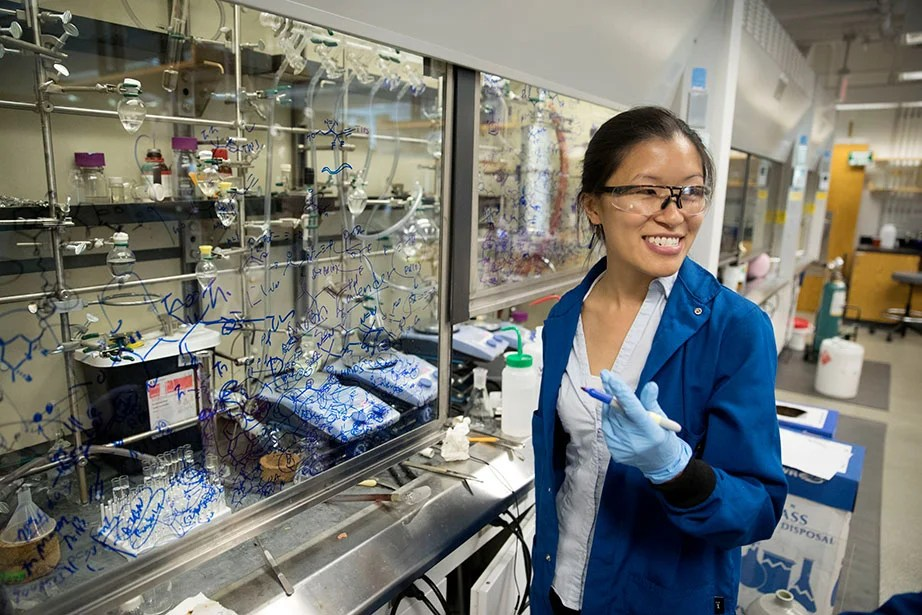 Professor Christina Woo works in her lab, which has been upgraded with equipment that meets high sustainability standards, including the most energy-efficient freezer on the market. New fume hood controls conserve energy by reducing airflow when not in use.